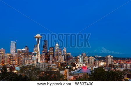 Seattle Downtown Skyline And Mt. Rainier At Night. Wa