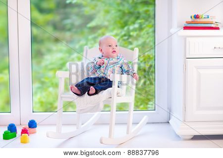 Baby Boy In A Rocking Chair