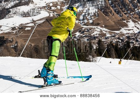 Yellow Dressed Skiers With Helmet Waiting For Skiing