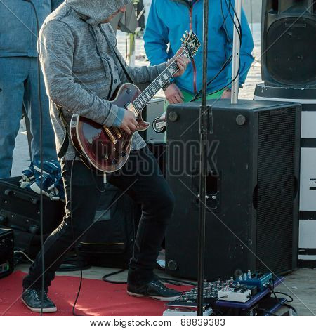 Hoodie Guitarist Playing Electrical Guitar On A Concert