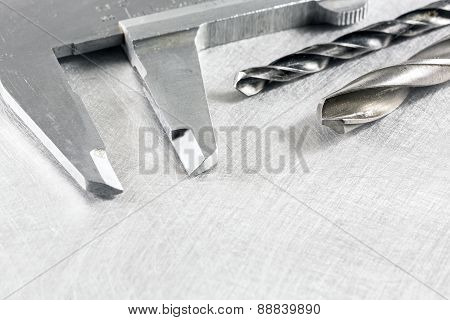 Vernier Caliper On Metal Surface