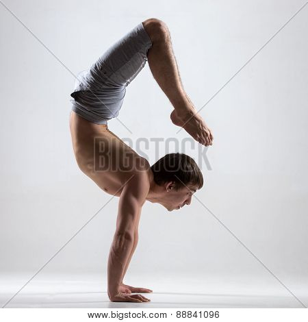 Yogi Man In Yoga Scorpion Pose, Side View