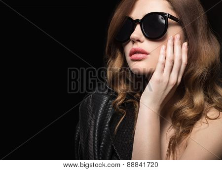Beautiful girl in dark sunglasses, with curls and evening makeup. Beauty face.