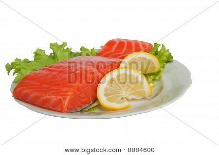 Salted Salmon With Lemon On Salad Leaves