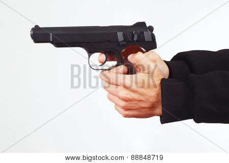 Hands with automatic pistol on white background
