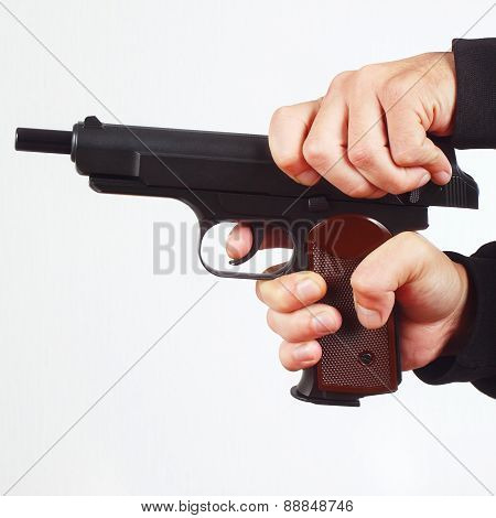 Hands reload semi-automatic gun on white background