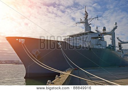 Naval Auxiliary Ship Docked At The Harbor.