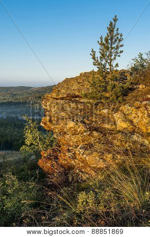 Rock lit by the sun in the Ural Mountains.
