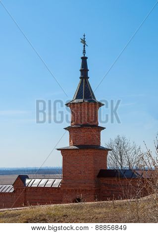 Tower with a weather vane
