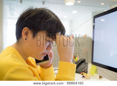 short hair young woman sitting stress while talking on the phone