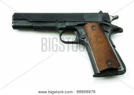 11 mm. Black gun isolated a white background.