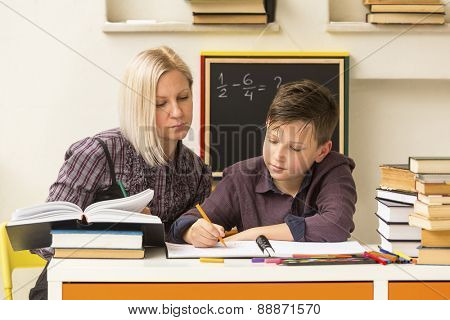 Young student engaged with the teacher.