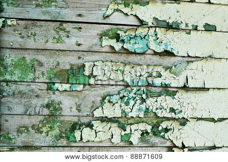 Peeling paint on old wooden wall