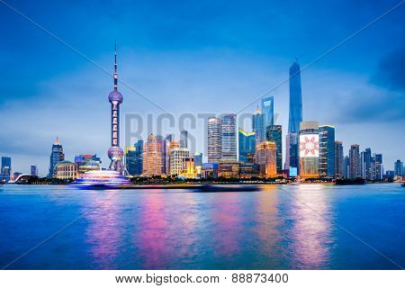 Shanghai, China financial district skyline on the Huangpu River.
