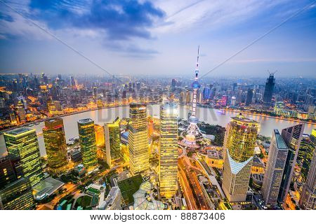 Shanghai, China city skyline over the Pudong Financial District.