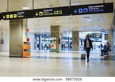 VALENCIA, SPAIN - APRIL 13, 2015: Airline passengers inside the Valencia Airport. About 4.59 million passengers passed through the airport in 2013.