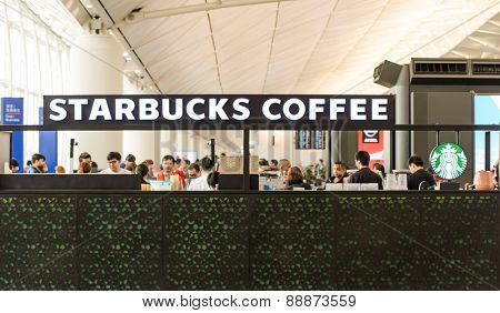 HONG KONG - MARCH 09, 2015: airport Starbucks cafe. Starbucks is the largest coffeehouse company in the world, with more then 23000 stores