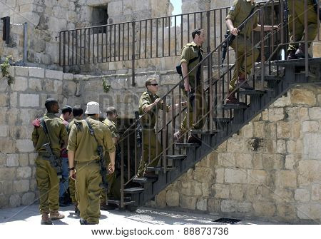 OLD CITY, JERUSALEM - JUNE 12: Young Israeli soldiers climb the steps leading to the Ramparts on top of the Old City wall on June 12, 2007.