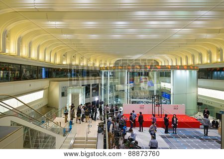 TOKYO, JAPAN - DECEMBER 28, 2012: News reporters set up inside the Tokyo Stock Exchange. It is the third largest exchang in the world.