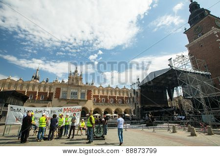 KRAKOW, POLAND - APR 24, 2015: Builders protest against of embezzlement during the construction of the new district (Inscription on the banner: Stop stealing on the construction of the