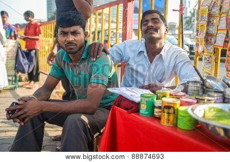 MUMBAI, INDIA - 08 JANUARY 2015: Indian vendors posing while waiting for customers.