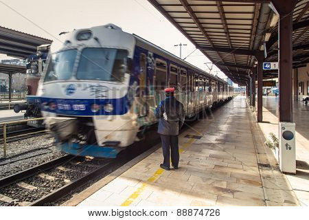 ZAGREB, CROATIA - 17 MARCH 2015: Controler next to a train that has just departed.