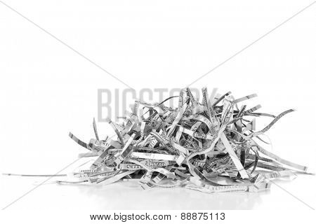 Destroyed money from shredder isolated on white