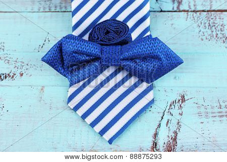 Male necktie and bow tie  wooden background