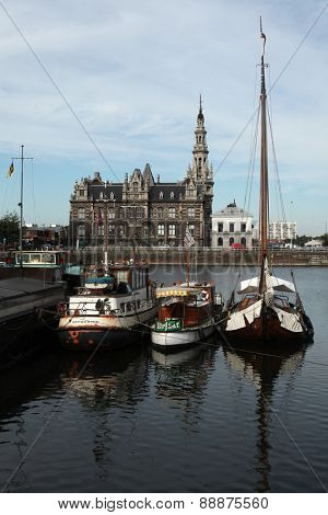 ANTWERP, BELGIUM - AUGUST 12, 2012: Yachts moored in the Bonaparte Dock next to the Pilotage Building (1894) in Antwerp, Belgium.