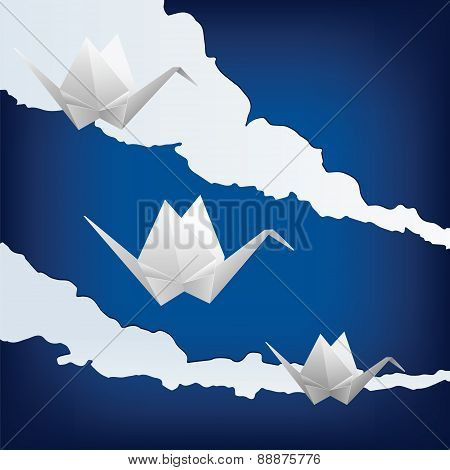 Three Paper Cranes Flying In The Sky
