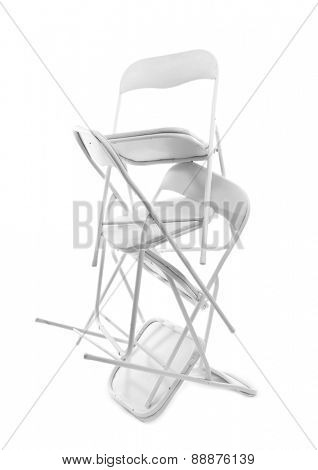 Stack of metal chairs isolated on white