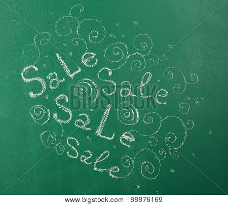 Sale inscription in chalk on  blackboard