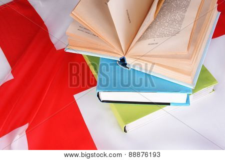 Books on England flag background