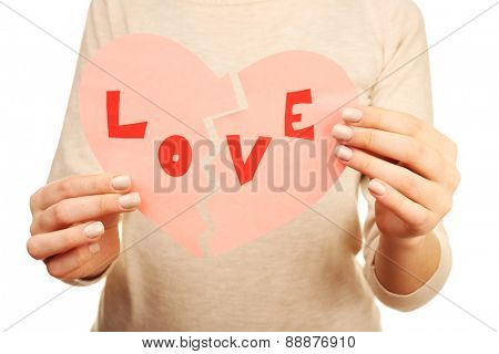 Woman holding broken heart close up