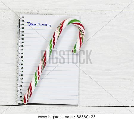 Santa Letter With Candy Cane On White Desktop