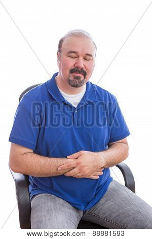 Thoughtful Adult Man On A Chair With Eyes Closed