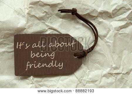 Brown Label With Quote About Being Friendly Paper Background