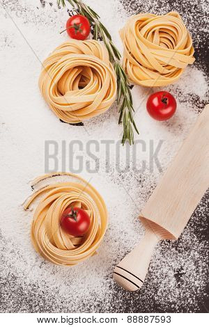 Pasta, tomatoes, rosemary on black