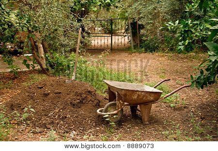 Wheel Barrow Next To Soil Heap