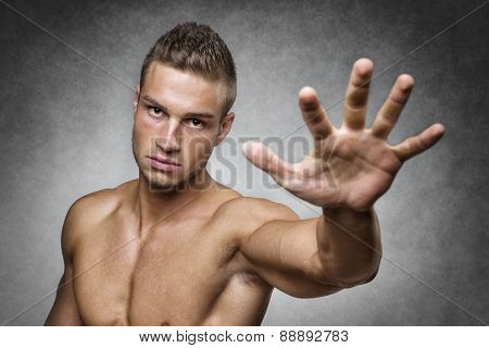 Athlete Holds Up His Hand