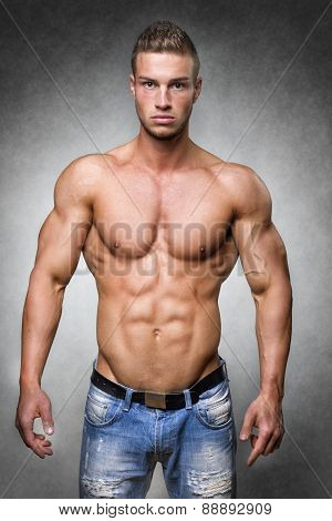 Athlete In Denim Trousers