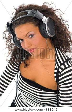 Beautiful Curly Brunette Girl Listening Music