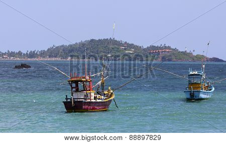 Colorful Fishing Boats on Blue Water