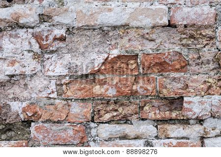 Crumbling Texture Of A Century Old Brick Wall