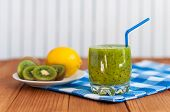 picture of light weight  - Healthy homemade kiwi juice in glass and fresh lemon - JPG