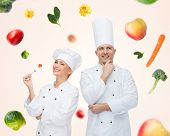 Постер, плакат: cooking profession inspiration vegetarian diet and people concept happy chef couple or cooks ea