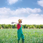 pic of hoe  - Farmer man with hoe looking at his orchard field with hat - JPG
