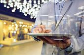 picture of mall  - Business Man using Mobile Digital Tablet in the Modern Shopping Mall - JPG