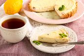 picture of cheesecake  - Lemon cheesecake with raisin and cup of tea  - JPG