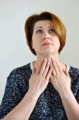 foto of throat  - Adult woman with a sore throat on a light background - JPG